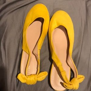 Yellow slip on shoes